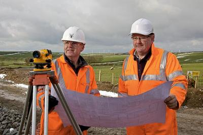 (LtoR) Phil Wooster, Ysgellog Site Manager, Raymond Brown Construction and Hywel Pritchard, Senior Partner, Pritchard Brothers, Rhosybol at Ysgellog Farm.