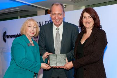 Maria McCaffery of RenewableUK presents Green Energy Award to Richard Mardon and Alison Hood of Airvolution Energy