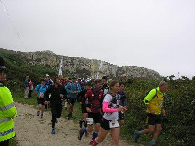 Marathon runners leave start line Holyhead Country Park